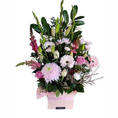 Pastel pink colored flowers gift box