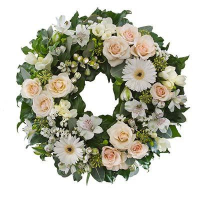 Sympathy flowers funeral wreath white cream blush flowers