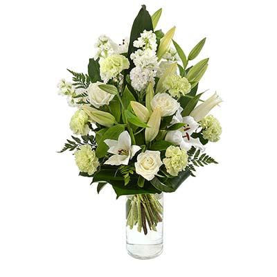 White flowers bouquet glass cylinder vase