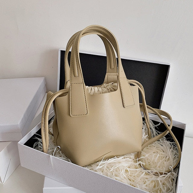 ladies-solid-color-bucket-shoulder-bag.jpg