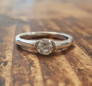 Silver and single stone CZ ring