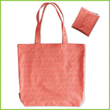 A reusable bag that can be folded away into a small pouch. This one is peach coloured.