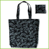 A reusable bag that can be folded into a small pouch. This one is black with small white butterflies printed all over.