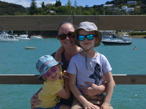 Kelly, founder of Reuseful, with her two children in front of the ocean on a summers day.