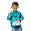 A little boy using a small snack bag from Bumkins with a wildlife design.