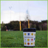 A reusable cup by CuppaCoffeeCup with the Rugby Road Code design sitting on rugby field.