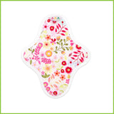 A reusable panty liner with a pink floral pattern known as 'Flower Garden Pink'.