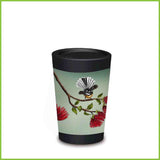 A CuppaCoffeeCup - A lightweight reusable coffee cup with a fantail perched on the branch of a pohutukawa tree.