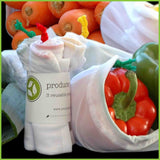 A three pack of reusable veggie bags from Pouch products, next to a bag holding a load of capsicums.