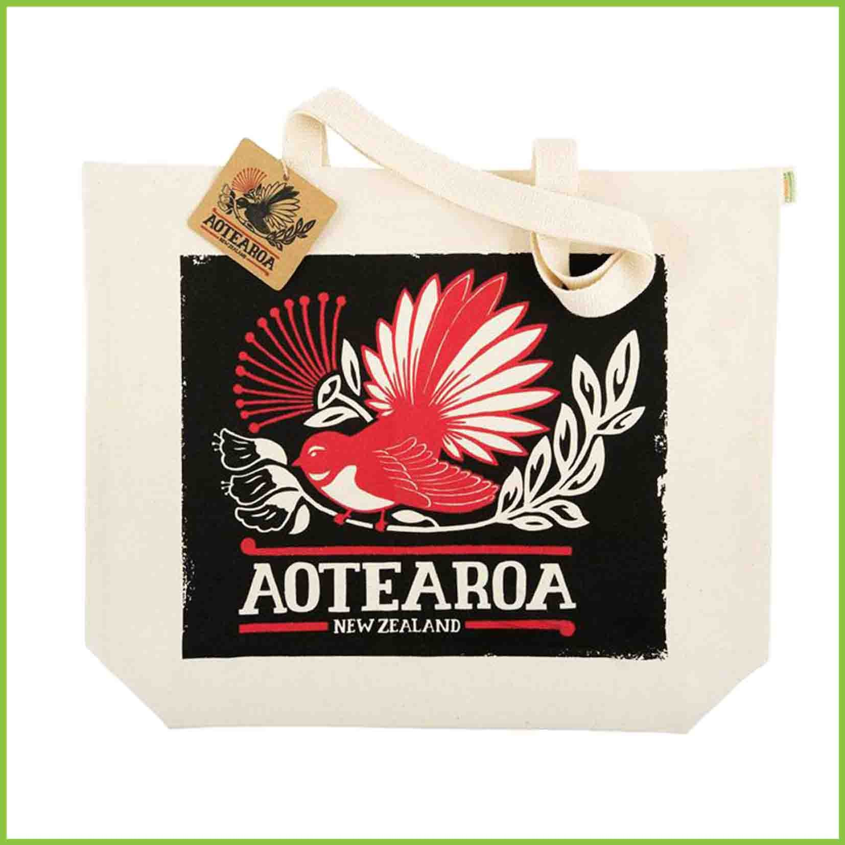 A strong reusable shopping bag made from organic cotton with a red and black design of a fantail and Aotearoa text.
