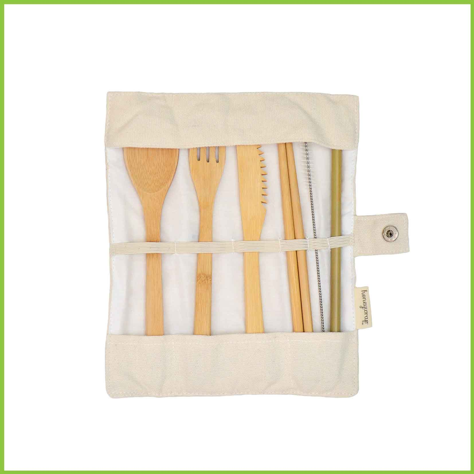 A bamboo cutlery set within a cream canvas case - includes a fork, spoon, knife, chopsticks, straw and cleaner brush.