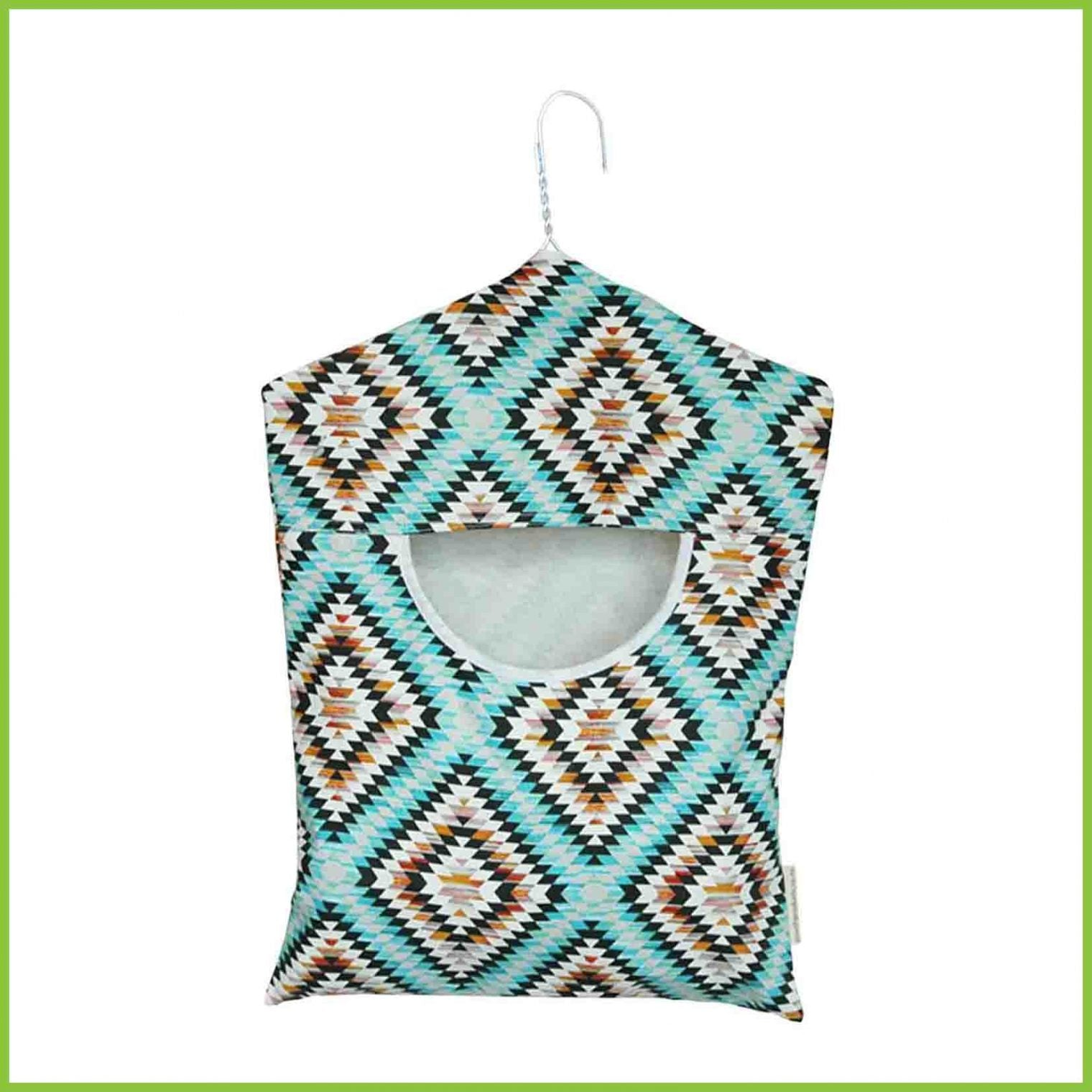 A cotton peg bag with an abstract aztec design in blue and grey.