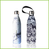 A reusable water bottle with a white marble effect finish. Standing next to it is it's carry cover with a deer and woodland inspired design.