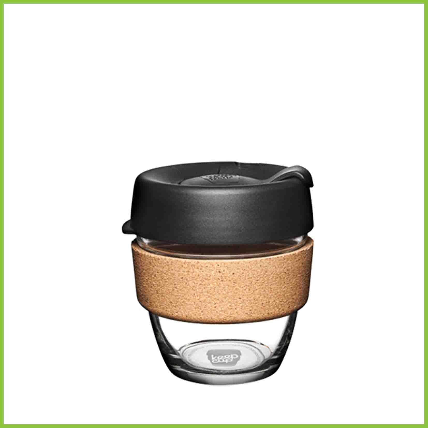 227ml reusable glass cup from Keepcup with a black lid and a cork band.