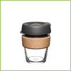 A medium KeepCup with a cork band and a dark grey lid.