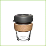 A 340ml KeepCup Cork. A glass reusable coffee cup with a cork band.