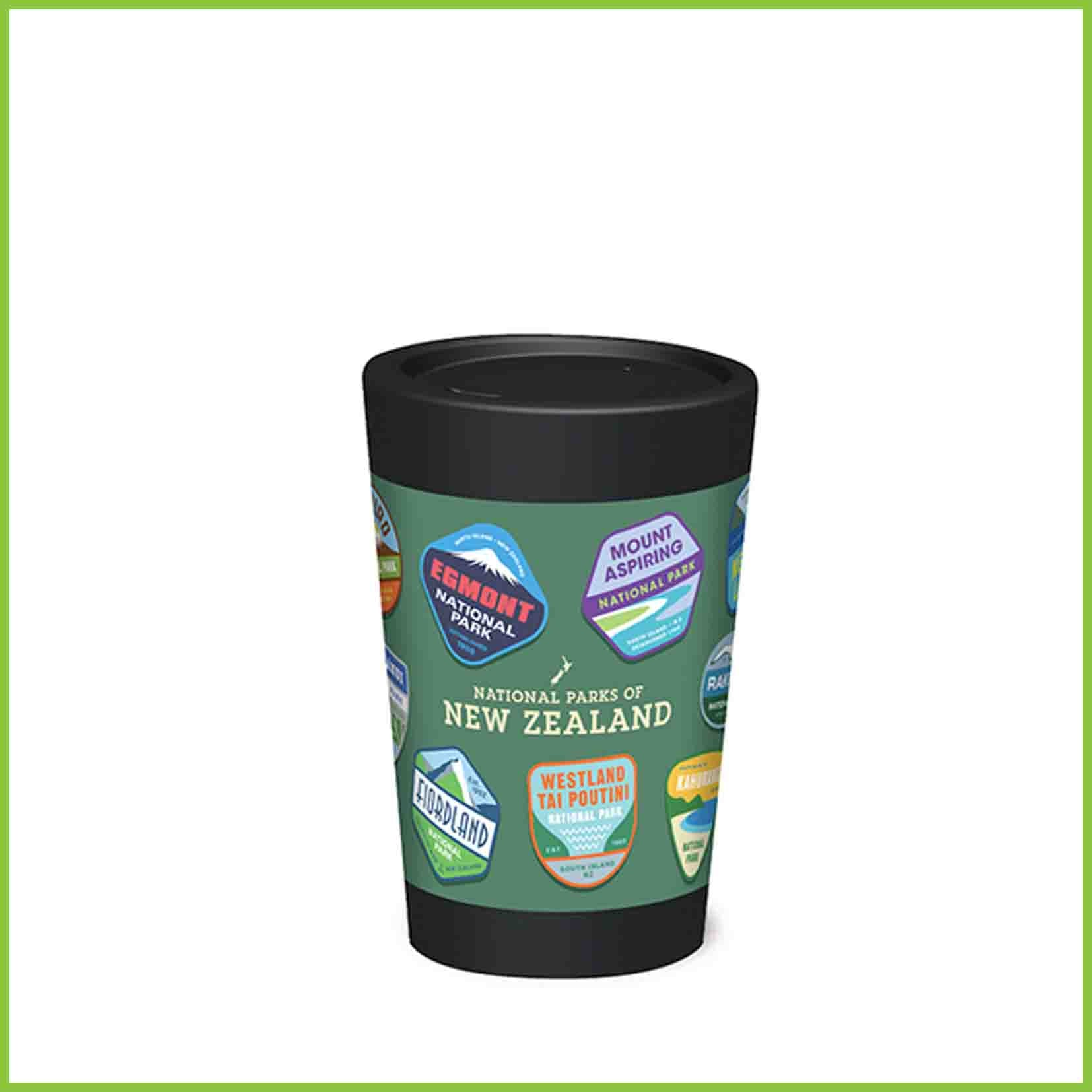 A reusable cup with a range of New Zealand National park badges.