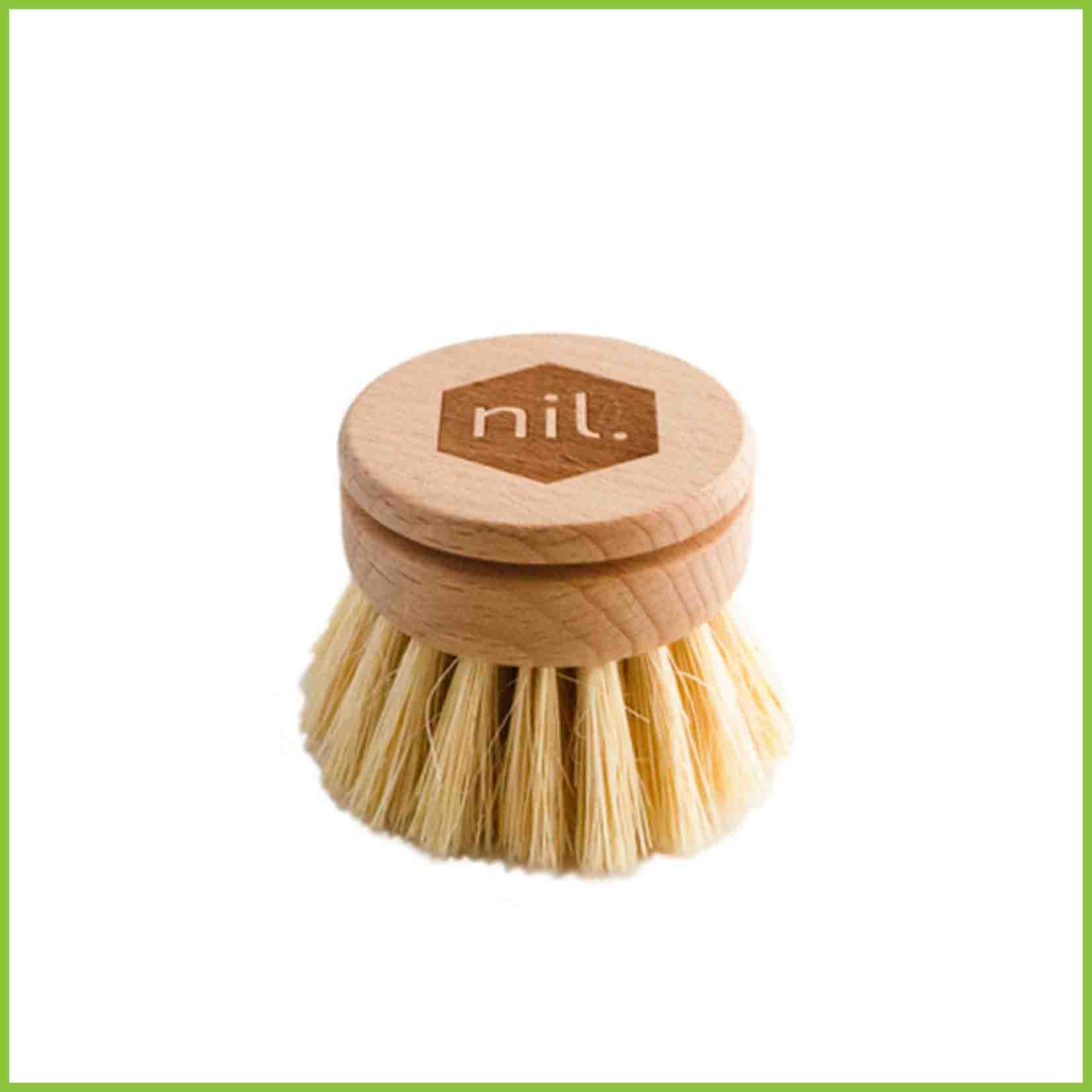 Wooden dish brush head with vegetable fibre bristles.