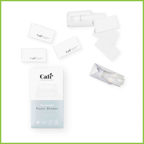 A pack of razor blades and single blades individually wrapped in paper.
