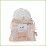 A small cotton bag holding 10 round cotton reusable make up pads.