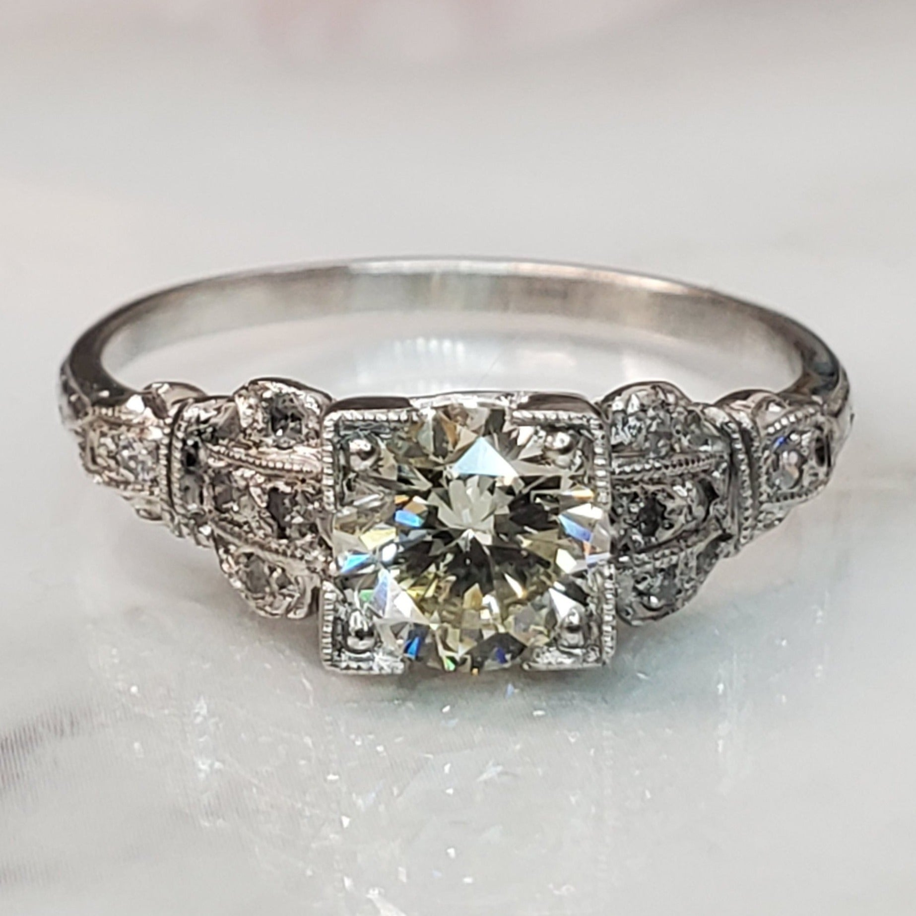 Platinum, 0.91 carat, round brilliant diamond, diamond accent, vintage ring