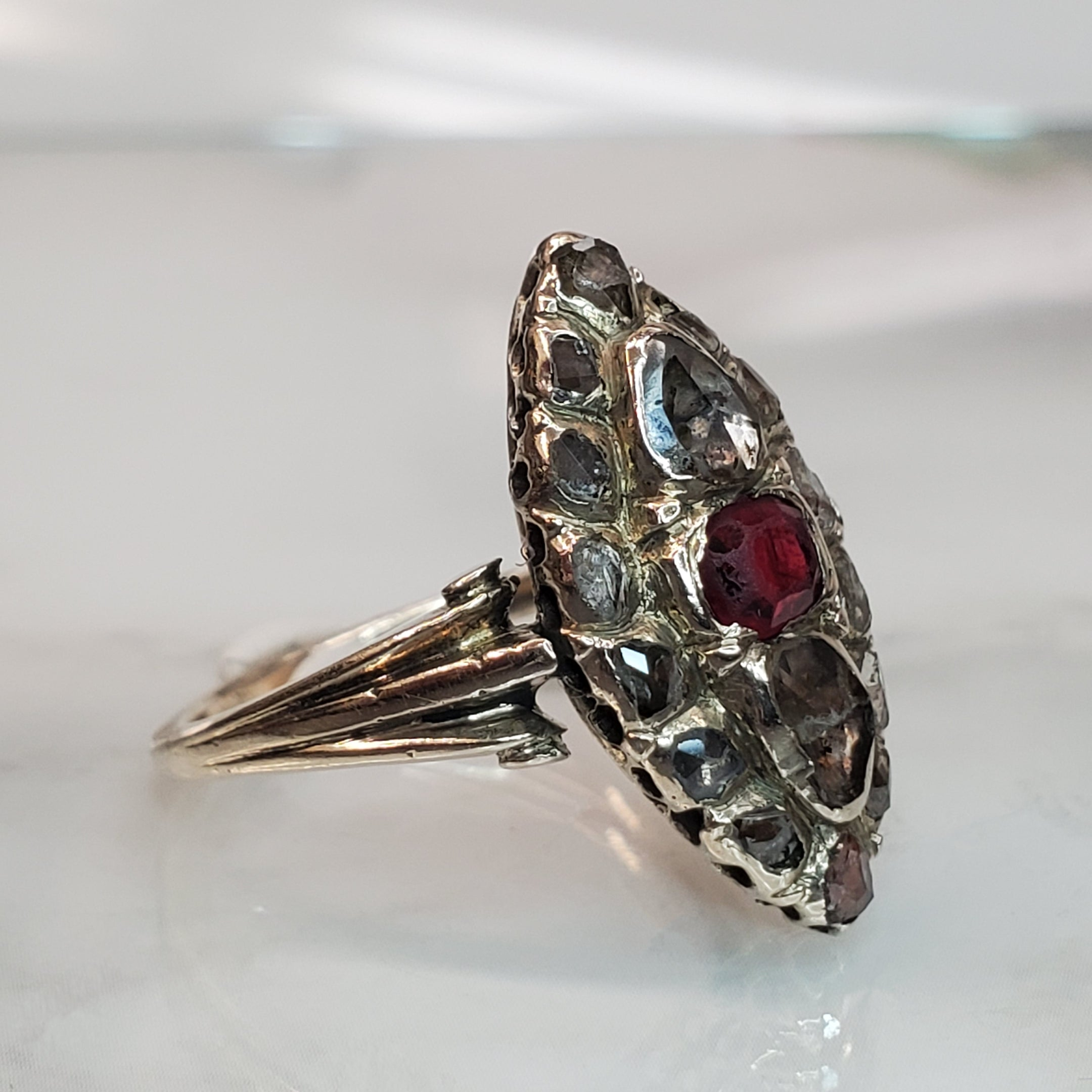 Antique Silver & 10 karat white gold navette ring with red spinel and antique diamonds