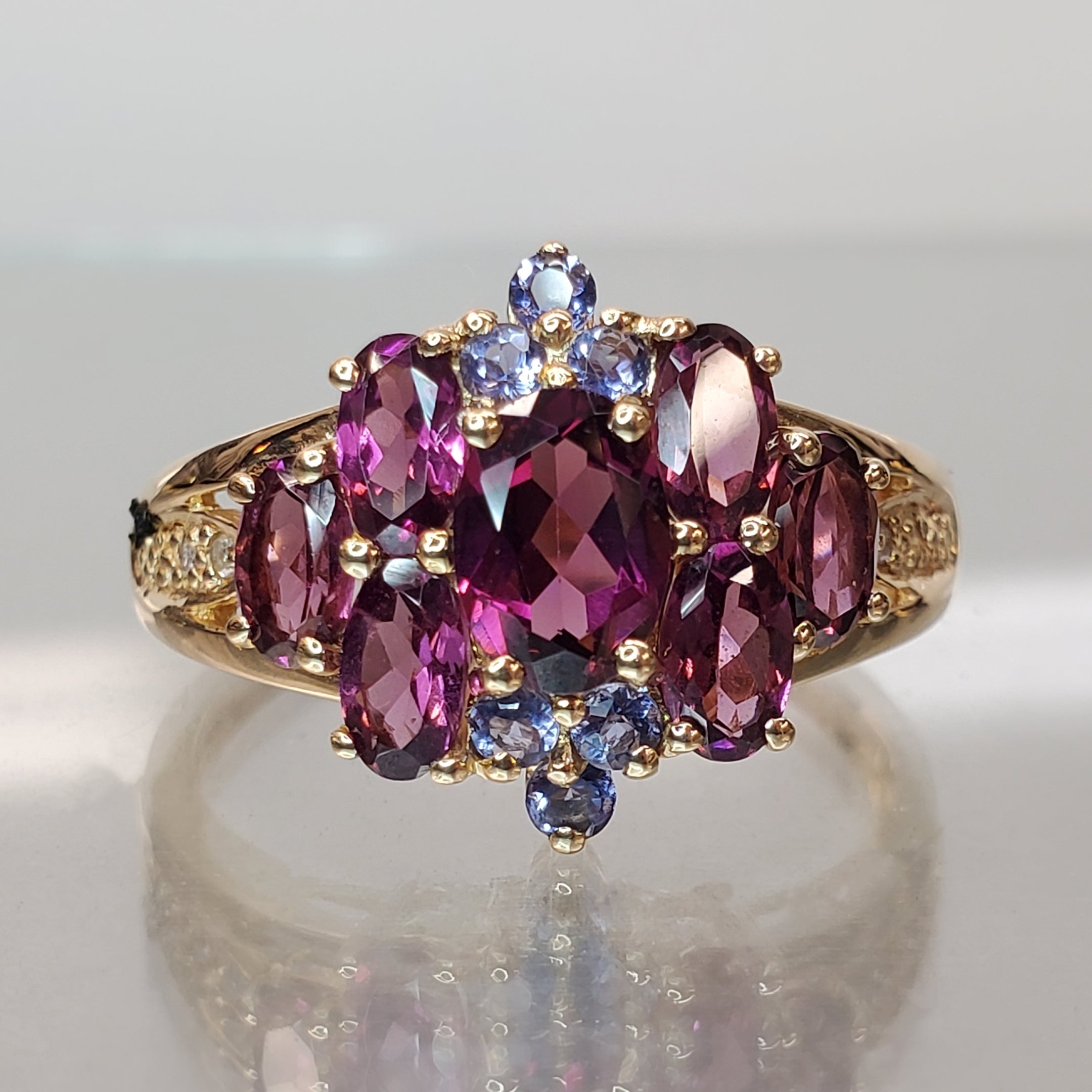 14 karat yellow gold, oval garnets and round tanzanite accent, estate ring