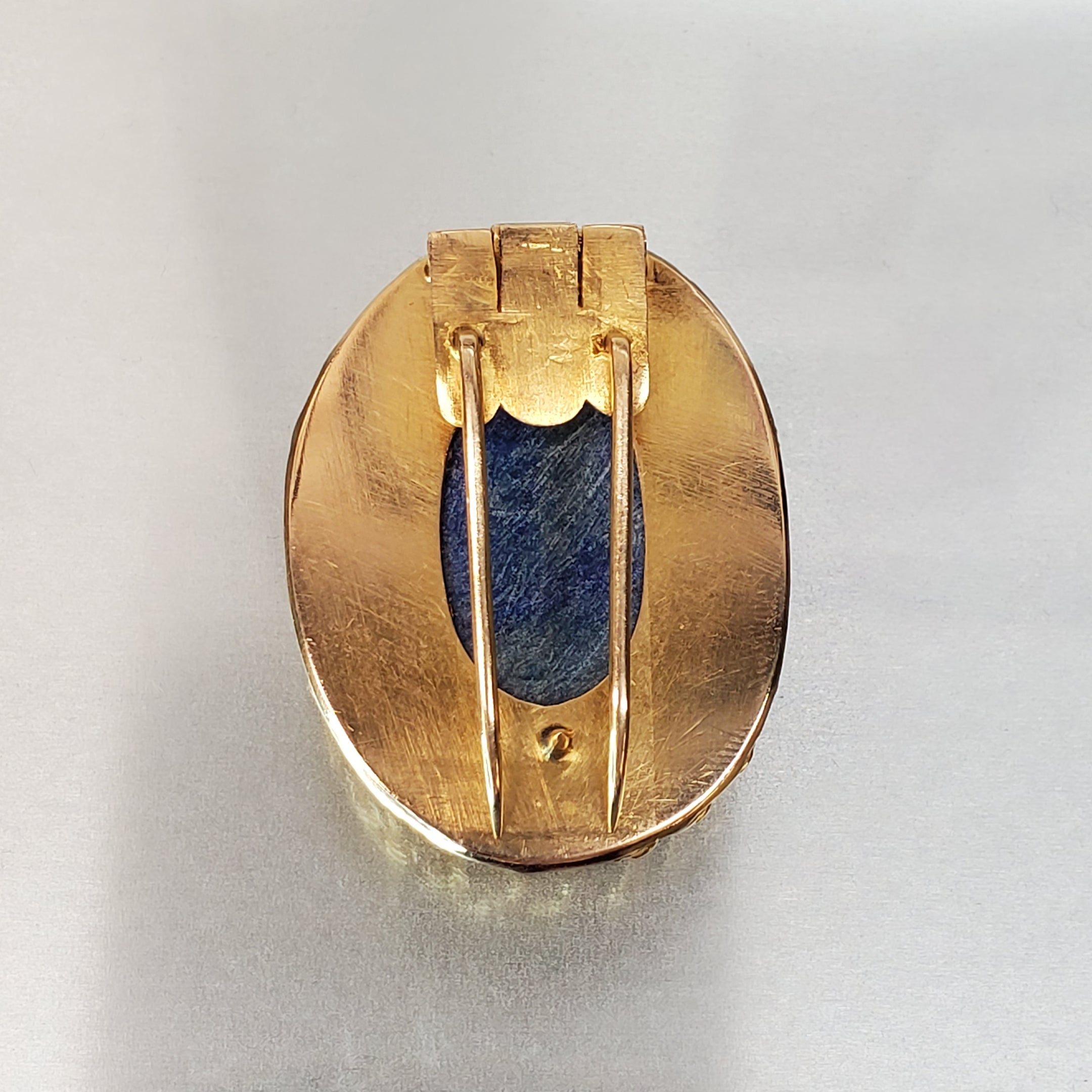 14 karat yellow gold, oval lapis cabochon, wire work frame, braided design, estate brooch