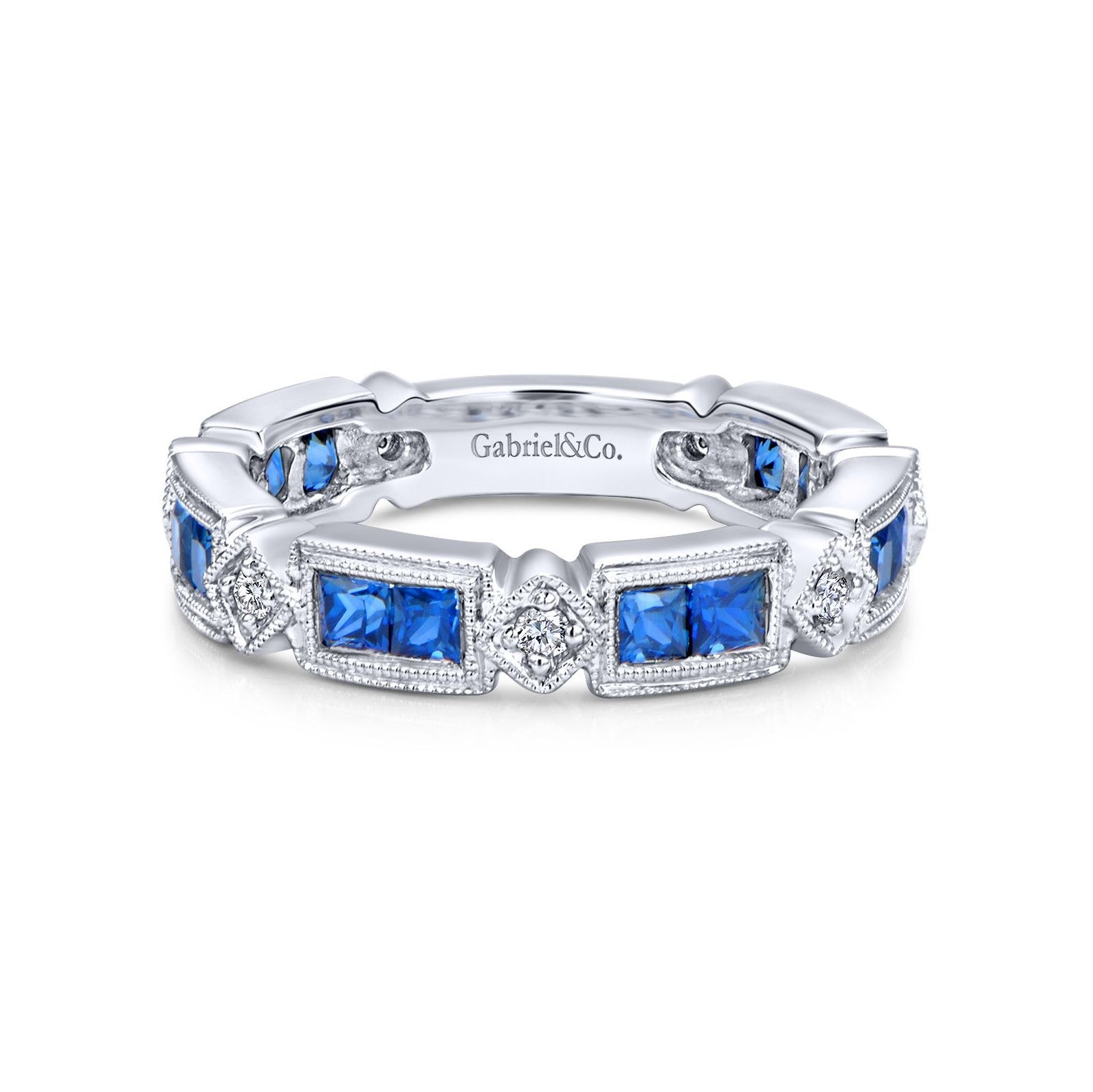 14 karat white gold, blue princess cut sapphires and round diamonds, eternity ring