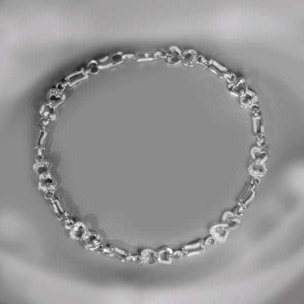 Platinum, heart-link, estate bracelet