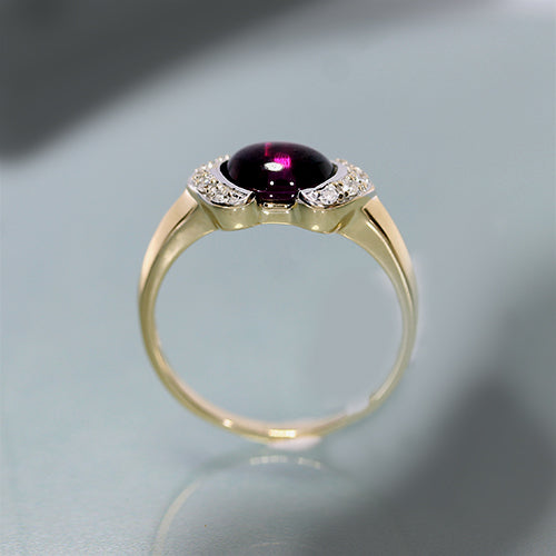 10 karat yellow gold, rhodalite garnet cabochon, diamond accent, estate ring