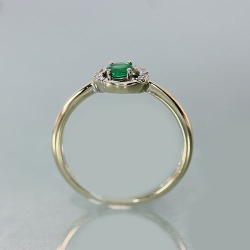 18 karat yellow gold, round emerald, diamond halo swirl design, estate ring