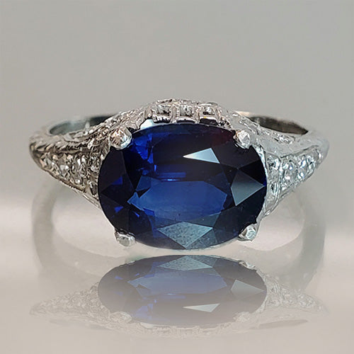 Platinum, 2.30 carat oval-cut blue sapphire, diamond accents, edwardian style, estate ring
