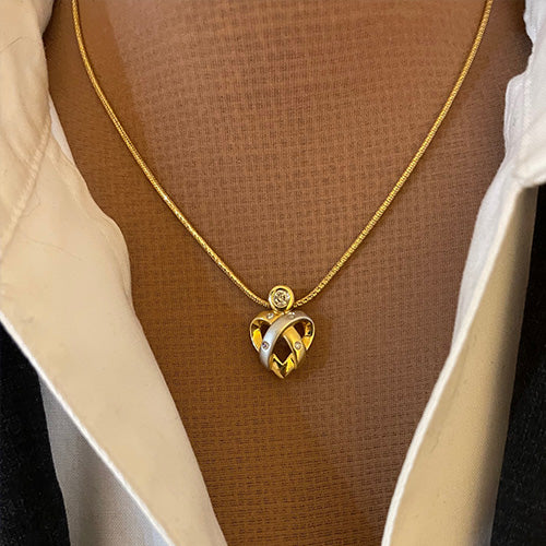 18 karat two-tone gold and diamond heart pendant estate necklace