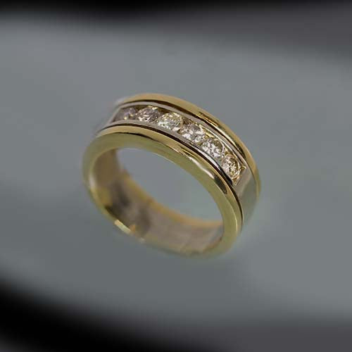 18 karat yellow and white gold, 0.90 total carat weight diamonds, six stones, estate ring