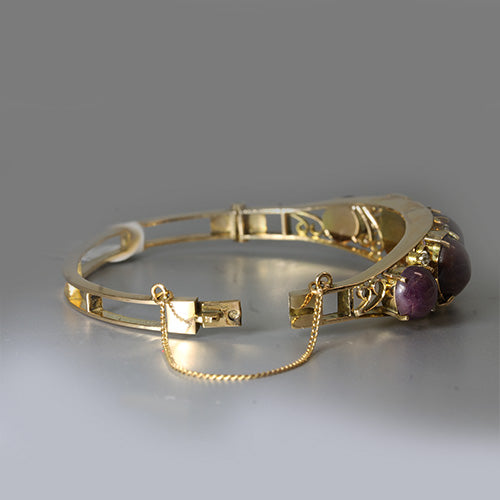 14 karat yellow gold, purple star sapphire cabochons, intricate gold wire work, diamond accents, vintage bangle bracelet