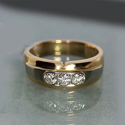 10 karat yellow and white gold, 0.50 total carat weight, diamond, three stone, estate ring