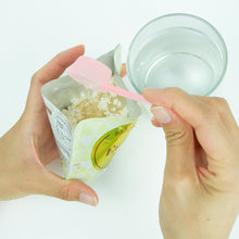 Load image into Gallery viewer, Step 2 - Use the provided measuring cup to add water to the packet and mix to a paste