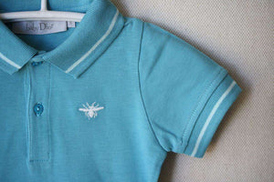 BABY DIOR TURQUOISE POLO SHIRT 9 MONTHS