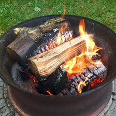 Fire wood burning in an open cast iron fire pit