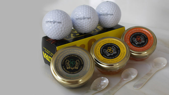 On Par Caviar Set - For the golf lover! 1oz Paddlefish, 1oz Bacon Infused Trout Roe, 1oz Bourbon Infused Trout Roe, 3 Mother of Pearl Spoons, and 3 CCC Wilson Ultra golf balls.