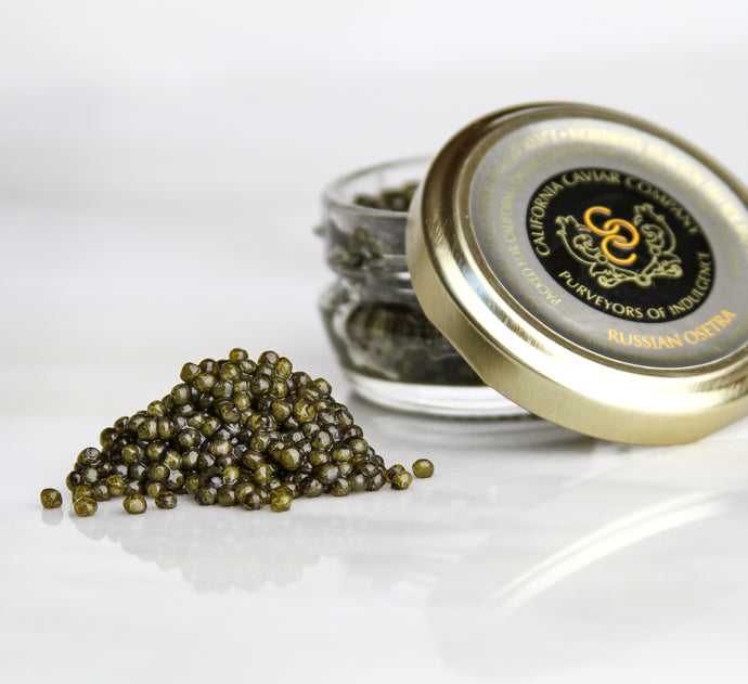 Golden Russian Ostera - Our sustainably farmed imported Russian Osetra caviar is best served simply — on a soft blini, lightly toasted brioche or straight on a pearl spoon along side a cold glass of brut champagne.