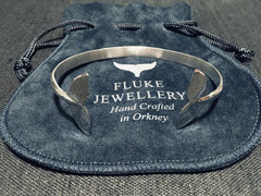 Orca tail bangle (polished) in Sterling Silver by Fluke Jewellery in Orkney, Scotland