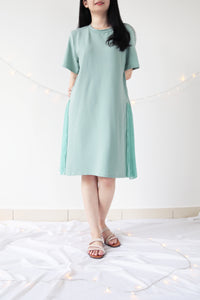 PLEATED SIDE HEM DRESS