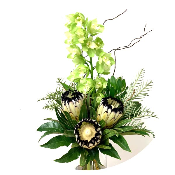 green cymbidium orchid with protea bouquet