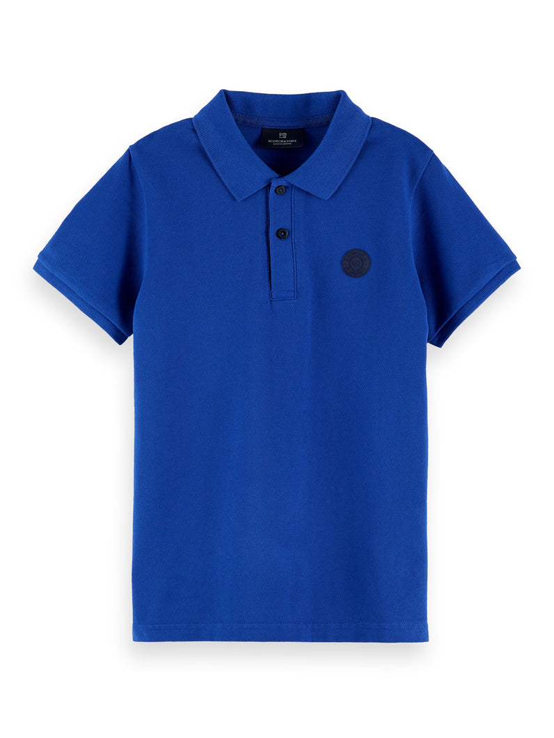 Fabric dyed polo with tonal chest artwork