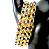 thin gold bangles with black and gold beads