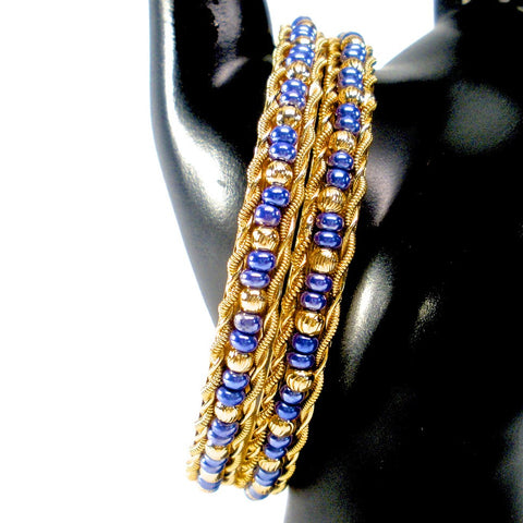 pair of gold bangles with beads