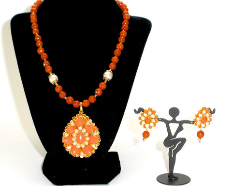 orange pachi pendant set with coordinated pearls and pachi studs