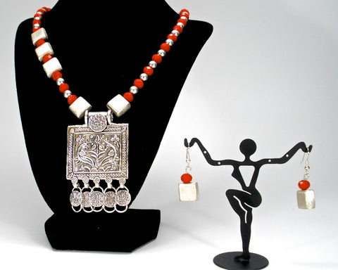 orange crystals with tribal pendant and square silver spacers
